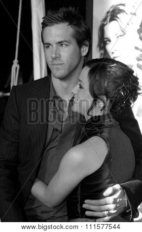 HOLLYWOOD, CA - DECEMBER 07, 2004: Ryan Reynolds and Alanis Morissette at the Los Angeles premiere of 'Blade: Trinity' held at the Grauman's Chinese Theater in Hollywood, USA on December 7, 2004.