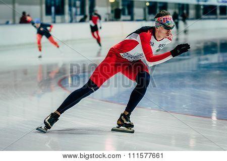 closeup man athlete skater warmup before start