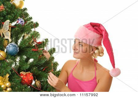 Santa girl decorating a beautiful Christmas tree