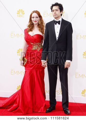 LOS ANGELES, CA - AUGUST 25, 2014: Christina Hendricks and Geoffrey Arend at the 66th Annual Primetime Emmy Awards held at the Nokia Theatre L.A. Live in Los Angeles, USA on August 25, 2014.