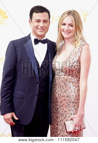 LOS ANGELES, CA - AUGUST 25, 2014: Jimmy Kimmel and Molly McNearney at the 66th Annual Primetime Emmy Awards held at the Nokia Theatre L.A. Live in Los Angeles, USA on August 25, 2014.