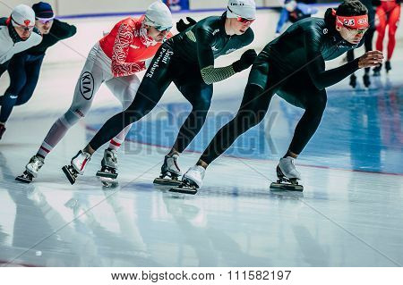 group men speedskater warming up before start