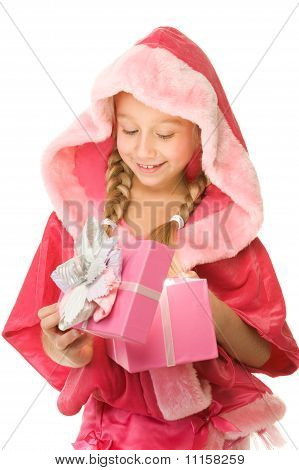 Little Christmas surprised girl open her present