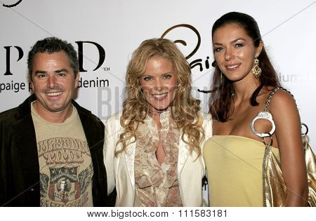 November 17, 2005 - Beverly Hills - Christopher Knight, Paige Adams-Geller and Adrianne Curry at the Paige Premium Denim Party at the Paige Premium Denim Flagship Store in Beverly Hills, USA..
