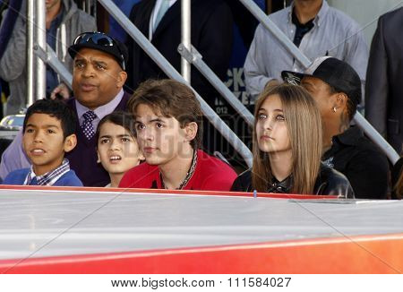 HOLLYWOOD, CA - JANUARY 26, 2012: Justin Bieber, Prince Michael Jackson, Blanket Jackson, and Paris Jackson at the Michael Jackson Immortalized held at the Grauman's Chinese Theatre in Los Angeles.