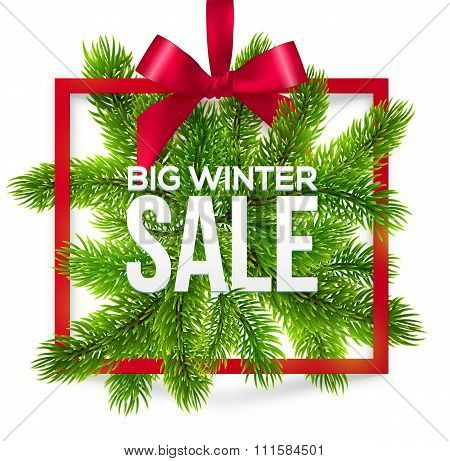 Big winter sale label with red ribbon and green fir tree branches
