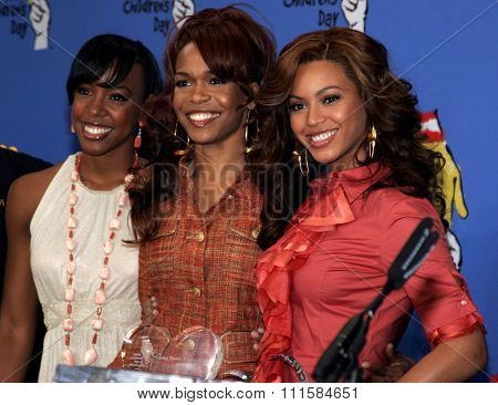 LOS ANGELES, CA - NOVEMBER 15, 2005: Kelly Rowland, Michelle Williams and Beyonce Knowles at the 2005 World Children's Day at the Ronald McDonald House in Los Angeles, USA on November 15, 2005.
