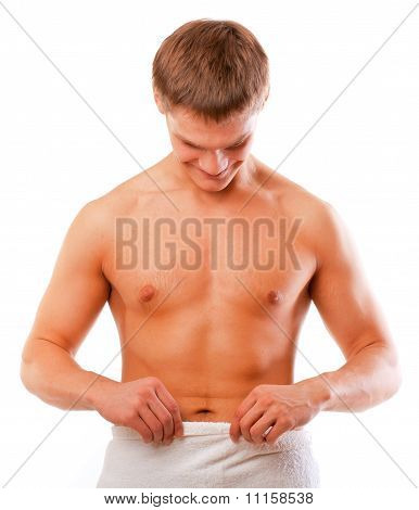 Happy young man looking at his penis isolated