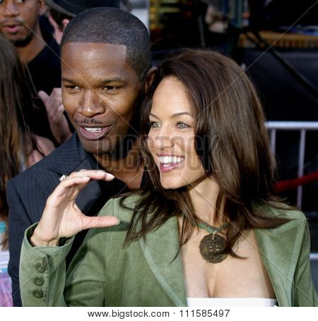 2 August 2004 - Los Angeles, California - Jamie Foxx and guest. The World Premiere of 'Collateral' at the Orpheum Theatre in downtown Los Angeles.