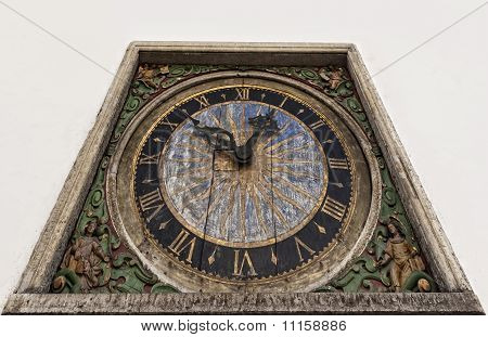 Ancient clock isolated on a white background