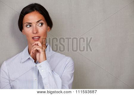 Reflective Businesswoman With Hand On Chin