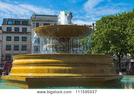 Fountain At Crowded Trafalgar Square. It Is One Of The Most Popular Tourist Attraction In London, Of