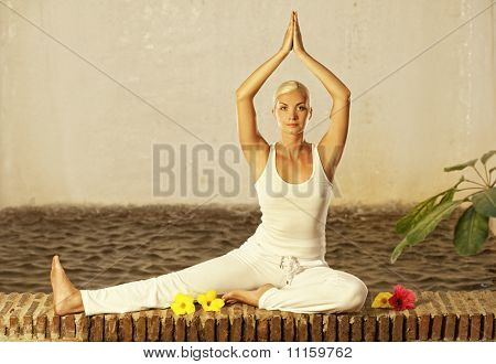 Beautiful young woman doing a yoga exercise