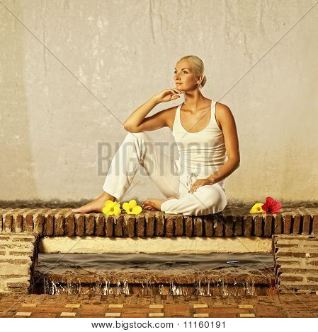 Very beautiful young woman relaxing after yoga