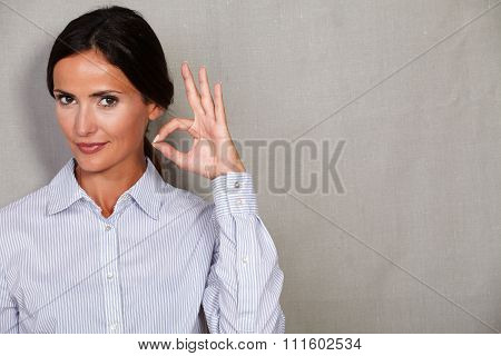 Well-dressed Female With Ok Sign Gesture