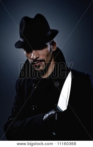 Scary man with a knife