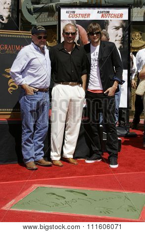 09/06/2006 - Hollywood - Andrew Davis, Kevin Costner and Ashton Kutcher attend the Kevin Costner Hand and Footprints Ceremony held at the Grauman's Chinese Theater in Hollywood, California, USA.