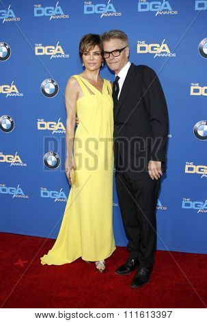 Lisa Rinna and Harry Hamlin at the 66th Annual Directors Guild Of America Awards held at the Hyatt Regency Century Plaza in Los Angeles, USA on January 25, 2014.