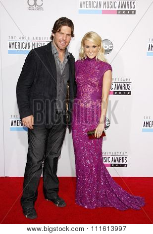 Mike Fisher and Carrie Underwood at the 40th American Music Awards held at the Nokia Theatre L.A. Live in Los Angeles, USA on November 18, 2012.