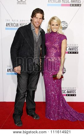 Carrie Underwood and Mike Fisher at the 2012 American Music Awards held at the Nokia Theatre L.A. Live in Los Angeles, USA on November 18, 2012.