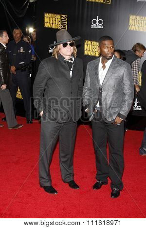 Val Kilmer and 50 Cent at the 2009 American Music Awards at Nokia Theatre L.A. Live in Los Angeles, USA on November 22, 2009.