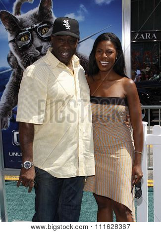 HOLLYWOOD, CALIFORNIA - July 25, 2010. Michael Clarke Duncan and Omarosa at the Los Angeles premiere of