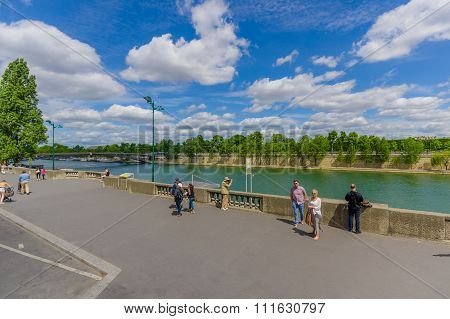 Tourists admiring the beautiful Seine river in Paris, France