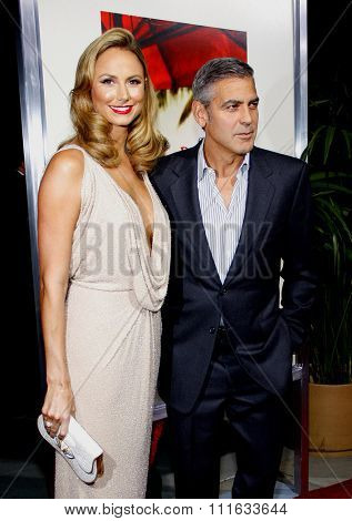 BEVERLY HILLS, CALIFORNIA - November 15, 2011. George Clooney and Stacy Keibler at the Los Angeles Premiere of