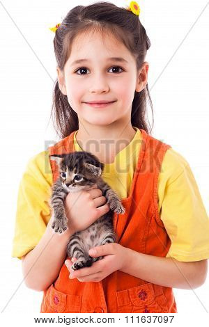 Little girl with kitty in hands