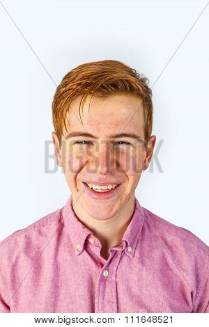 Portrait Of Attractive Laughing Smiling Boy Isolated On White