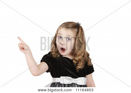 Girl pointing with open mouth