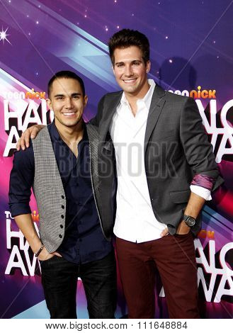 LOS ANGELES, CALIFORNIA - November 17, 2012. James Maslow and Carlos Pena at the 2012 Halo Awards held at the Hollywood Palladium in Los Angeles.