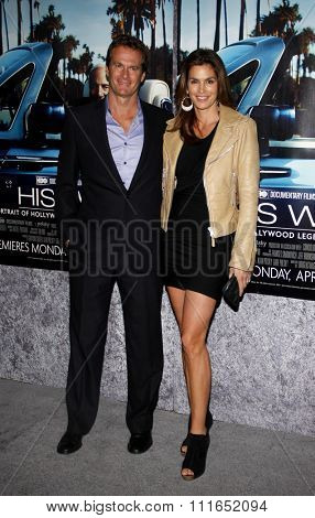 HOLLYWOOD, CALIFORNIA - March 22, 2011. Cindy Crawford and Rande Gerber at the Los Angeles premiere of