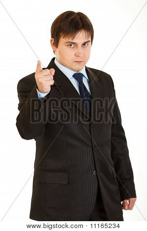 Strict young businessman shaking his finger isolated on white
