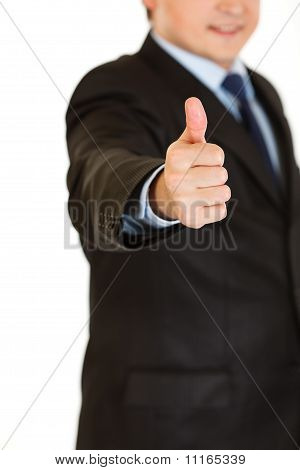 Smiling businessman showing thumbs up gesture isolated on white. Close-up.