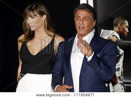 Sylvester Stallone and Jennifer Flavin at the Los Angeles premiere of 'Creed' held at the Regency Village Theatre in Westwood, USA on November 19, 2015.