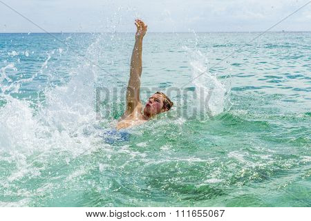Handsome Teen Backstroking In The Ocean