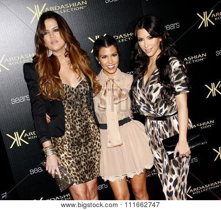 Kim Kardashian, Khloe Kardashian and Kourtney Kardashian at the Kardashian Kollection Launch Party held at the Colony in Hollywood, USA on August 17, 2011.