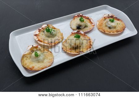 Baked Parmesan Scallops On Black Background