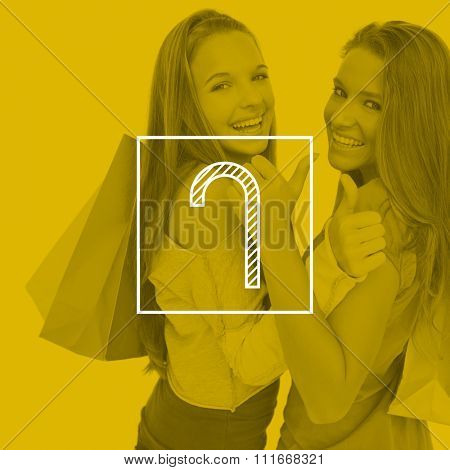 Rear view of two young women the thumbup with shopping bags against candy cane