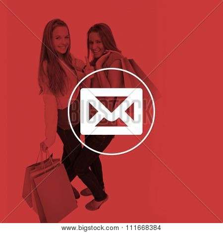 Two beautiful young women with shopping bags the thumbup against envelope