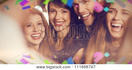 Flying colours against drunk friends laughing with barman