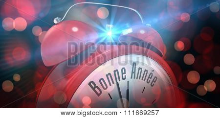 Bonne annee in red alarm clock against red glowing dots on black