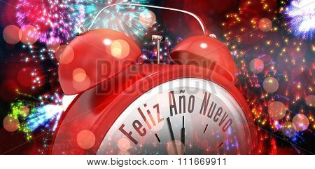 Feliz ano nuevo in red alarm clock against colourful fireworks exploding on black background
