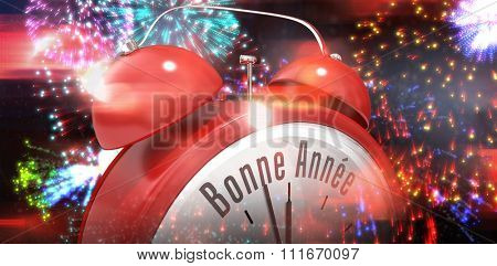 Bonne annee in red alarm clock against colourful fireworks exploding on black background