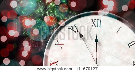 Roman numeral clock counting down against colourful fireworks exploding on black background