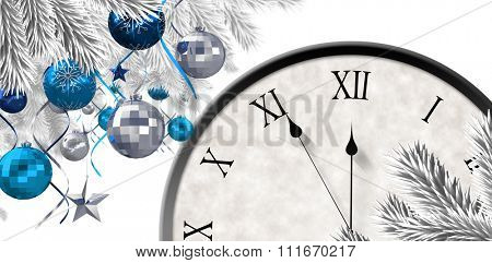 Christmas tree decorated with golden ornaments against roman numeral clock counting down
