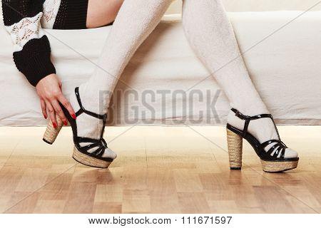 Female Legs In Woolen Stockings Heeled Shoes