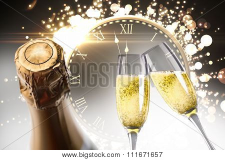 Champagne glasses clinking against clock counting down to midnight