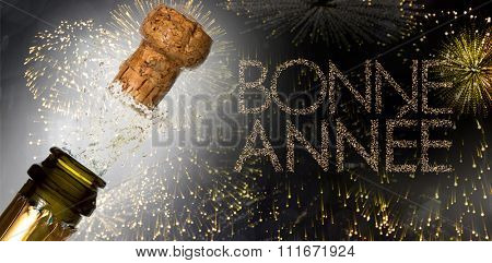 Close up of champagne cork popping against glittering bonne annee